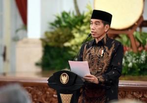 Presiden Jokowi memberikan sambutan pada acara Peringatan Nuzulul Quran Tahun 1439 H/2018 M Tingkat Nasional, di Istana Negara, Jakarta, Senin (4/6) malam. (Foto: JAY/Humas)